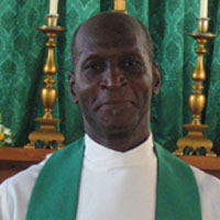 Priest in Charge The Rev'd Canon Clement Francis M.P.S (Emeritus)